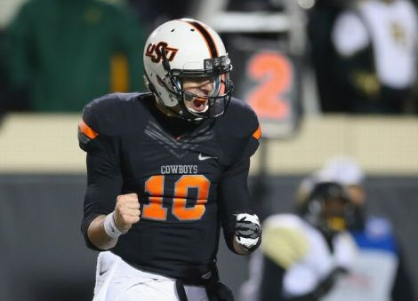 STILLWATER, OK - NOVEMBER 23: Clint Chelf #10 of the Oklahoma State Cowboys celebrates a touchdown against the Baylor Bears in the third quarter at Boone Pickens Stadium on November 23, 2013 in Stillwater, Oklahoma. (Photo by Ronald Martinez/Getty Images)